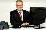 4551257-happy-aged-corporate-man-typing-on-keyboard