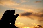 man_praying_hill