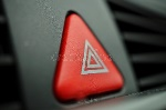 red-car-warning-button-white-triangle-switching-all-vehicle-outdoor-indicators-as-symbol-caution-warning-po-75345889