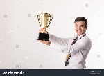 stock-photo-winner-businessman-holding-golden-trophy-after-success-in-his-business-507465154