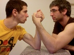 Two_young_men_arm_wrestling