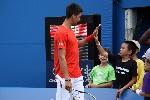 Novak_Djokovic_Giving_a_High_Five