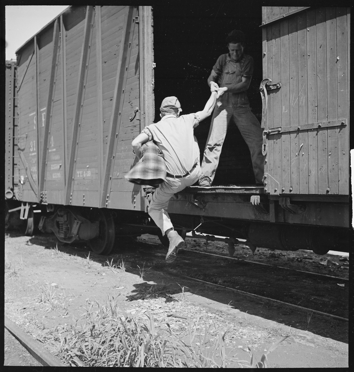 lossy-page1-1200px-Bakersfield,_California._On_the_Freights._Helping_a_newcomer_hop_a_freight_-_NARA_-_532069.tif