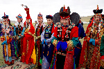 Men_and_Women_in_Traditional_Mongolian_Dress_Look_on_as_Secretary_Kerry_Attends_a_'Mini-Nadaam'_at_a_Field_Outside_of_Ulaanbaatar_(27506837976)