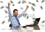 stock-photo-businessman-with-his-hands-raised-while-working-on-laptop-with-money-rain-139989340