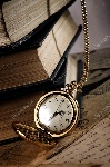 depositphotos_32829071-stock-photo-vintage-pocket-clock-and-old