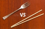 wooden-pairs-chopsticks-vs-fork-abstract-conceptual-image-table-74993924