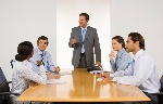 man-presenting-in-board-room