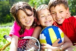 three-children-with-sports-equipment-embracing-1