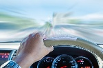 hand-driver-holding-steering-wheel-driving-fast-speed-motion-63433615