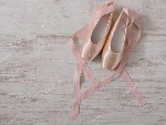 depositphotos_128468476-stock-photo-pink-ballet-pointe-shoes-on