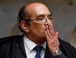 75978080_brazilian-supreme-court-judge-gilmar-mendes-gestures-at-the-start-of-brazils-supreme-c