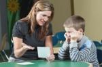 teacher-boy-student-tutoring