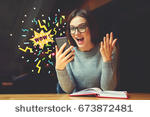 stock-photo-surprised-young-female-blogger-reading-shocked-news-in-message-on-mobile-phone-hipster-girl-673872481