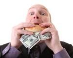 greed-avarice-consuming-dollars-12217179