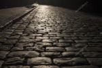 depositphotos_127498916-stock-photo-black-cobbled-stone-road-background