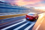 Car-driving-on-freeway-at-sunset-motion-blur-full-speed-06photos