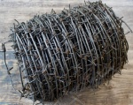 depositphotos_77100575-stock-photo-roll-of-barbed-wire-on
