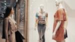 depositphotos_131796166-stock-video-girl-chooses-a-dress-in