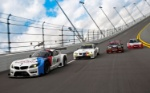 2013-BMW-Z4-GTE-race-car-leading-historic-BMW-racers-at-Daytona
