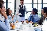 depositphotos_103265846-stock-photo-waiter-serving-coffee-to-business