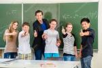 depositphotos_82619006-stock-photo-teacher-motivating-students-in-school