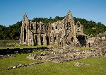 1200px-Tintern_Abbey_and_Courtyard