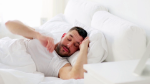 videoblocks-rest-sleeping-and-people-concept-man-waking-up-in-bed-at-home_b-9hrk8b_thumbnail-full01