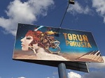 200px-Bilbord_z_hasłem_reklamowym_Torunia1