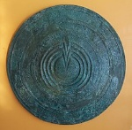 220px-Bronze_votive_shield
