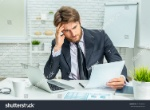 stock-photo-tired-businessman-at-work-in-office-317826464